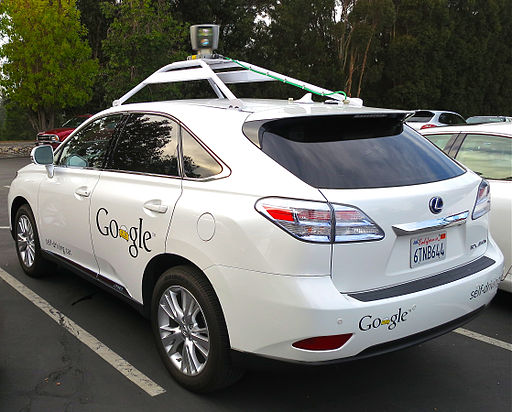 A Lexus RX450h retrofitted by Google to be Driverless. Photo credit: By Driving_Google_Self-Driving_Car.jpg: Steve Jurvetson derivative work: Mariordo [CC-BY-2.0 (http://creativecommons.org/licenses/by/2.0)], via Wikimedia Commons